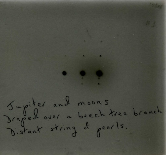 A haiku fused with an October 1973 photographic plate of Jupiter and moons.
