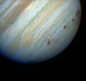 Brown dots indicate where Comet Shoemaker-Levy 9 impacted Jupiter's atmosphere in July 1994.  Image credit: NASA/Hubble Space Telescope Comet Team